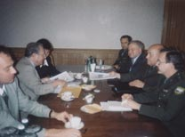 Stone talking to Baluevsky across table in Moscow.  Yesin is on Baluevsky's right.